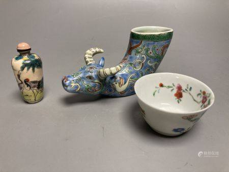 A Chinese famille rose cup, an ox rhyton cup and an enamel on copper snuff bottleCONDITION: The