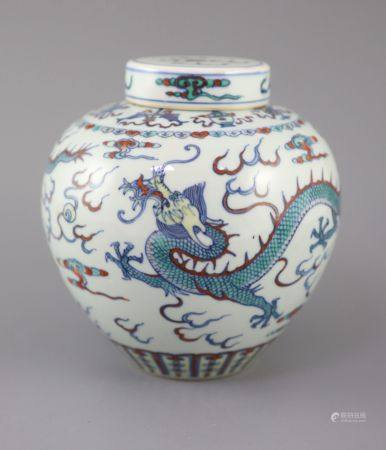 A Chinese doucai 'dragon' jar and cover, Qianlong seal mark, late 19th/early 20th century, the ovoid