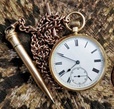 18CT GOLD OPEN FACED POCKET WATCH having enamel dial with Roman numeral chapter ring and