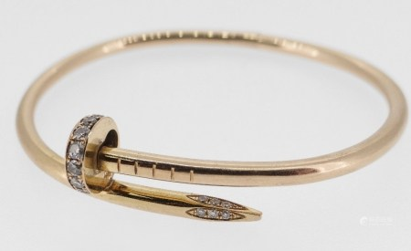 CARTIER 18CT GOLD DIAMOND SET 'JUSTE UN CLOU' BRACELET of coiled nail design with hidden clasp
