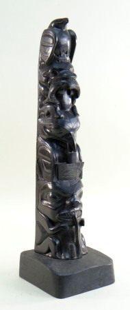 ARTHUR MOODY (1887-1967) haida argillite - Totem pole, carved with a sea eagle with fish, bear