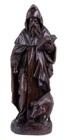 AN EARLY 16TH-CENTURY OAK SCULPTURE OF SAINT ANTHONY THE ABBOT. MARKED WITH THE ANTWERP HAND.
