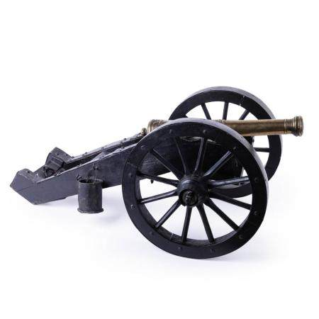 A 19TH-CENTURY BRONZE GRIBEAUVAL TYPE CANNON. MOUNTED ON AN IRON-CLAD WOODEN FIELD CARRIAGE WITH IRO