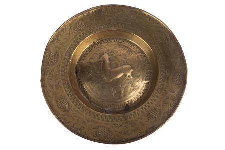 A 17TH-CENTURY ALMS DISH IN BRASS FROM THE SOUTHERN NETHERLANDS. DECORATED WITH A DEER IN MEDALLION