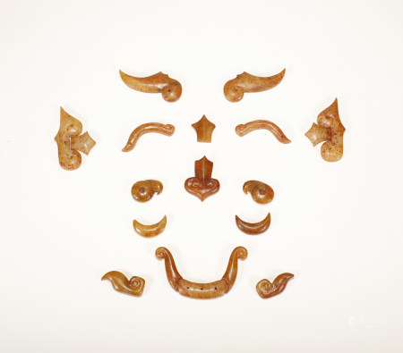 A SET OF CHINESE VINTAGE JADE MASK PIECES
