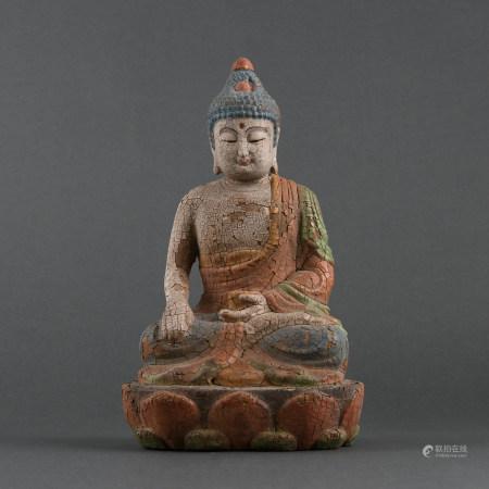 A POLYCHROME AND CARVED WOOD BUDDHA