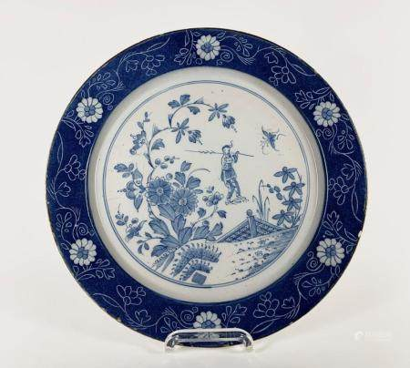 Large plate decorated with a Chinese figure