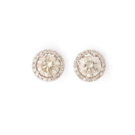 A pair of diamond and eighteen karat white gold stud earrings