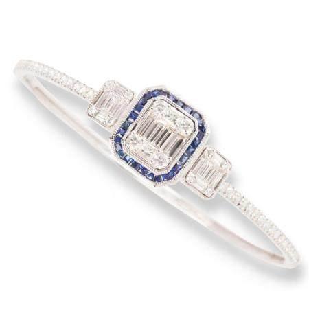 A sapphire, diamond and eighteen karat white gold bangle bracelet