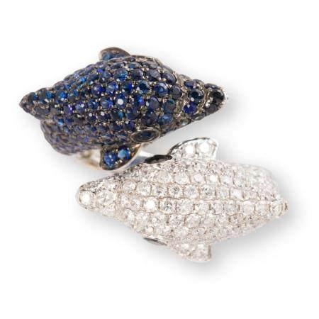 A diamond, sapphire and eighteen karat white gold ring