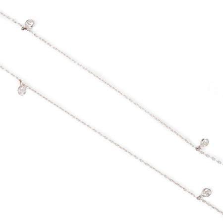 A diamond and fourteen karat white gold necklace