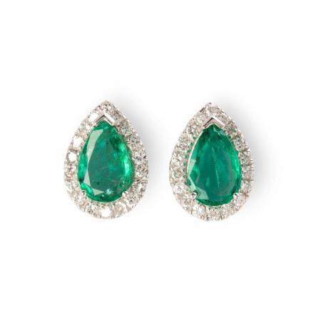 A pair of emerald, diamond and eighteen karat white gold earrings