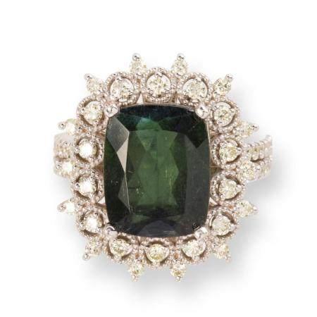 A green tourmaline, diamond and eighteen karat white gold ring