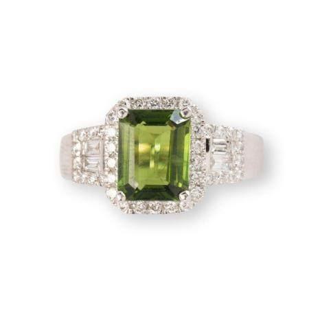 A green sapphire, diamond and platinum ring