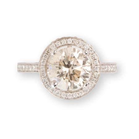 A diamond and eighteen karat white gold ring