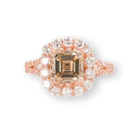 A fancy yellowish brown diamond and eighteen karat rose gold ring