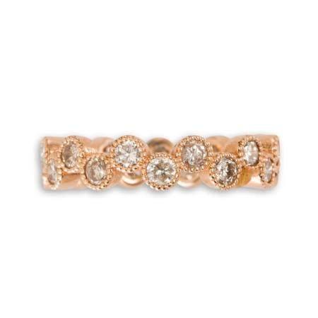 A diamond and eighteen karat rose gold band ring