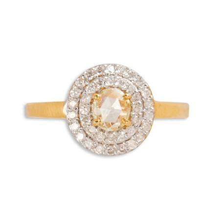 A yellow and near colorless diamond and eighteen karat gold ring