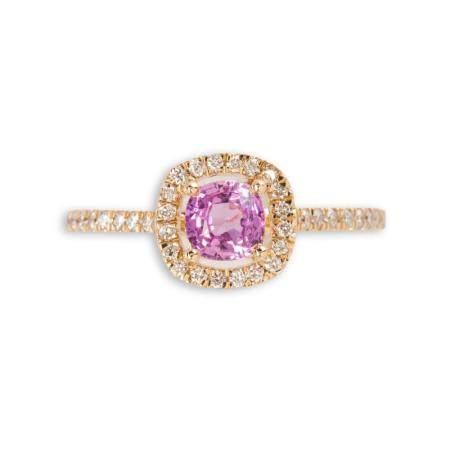 A pink sapphire, diamond and fourteen karat gold ring