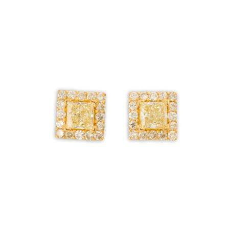 A pair of yellow and near colorless diamond and eighteen karat gold stud earrings