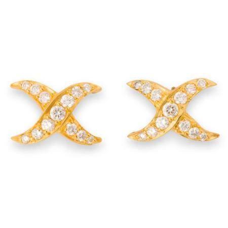 A pair of diamond and eighteen karat gold stud earrings