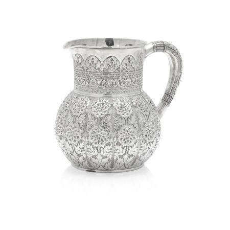 AN AMERICAN STERLING SILVER REPOUSSÉ WATER PITCHER by Tiffany & Co., New York, NY, 1873-1891