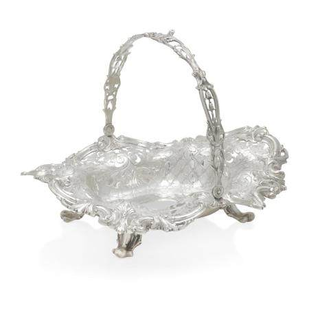 AN AMERICAN STERLING SILVER REPOUSSÉ CAKE BASKET by Frank W. Smith Silver Co., Gardner, MA, retailed by Shreve & Co., San Francisco, CA, 20th century