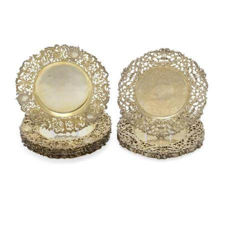 TWO SETS OF AMERICAN SILVER-GILT RETICULATED PLATES by Howard & Co., New York, NY, 20th century
