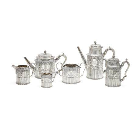 A VICTORIAN SILVER SIX-PIECE REPOUSSÉ COFFEE AND TEA SERVICE by Susannah Brasted, London, 1888-1889