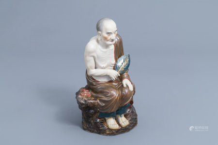 A Chinese Luohan figure in polychrome porcelain and biscuit, 20th C.