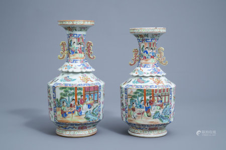 Two Chinese Canton famille rose vases with a lotus shaped neck, 19th C.