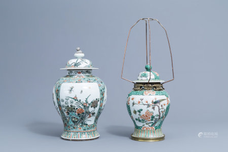 Two Cinese famille verte vases and covers with birds and butterflies among blossoming flowers, 19th/20th C.