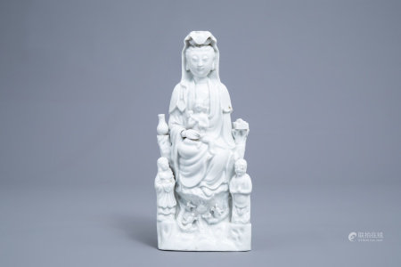 A Chinese blanc de Chine group of Guanyin with servants, 19th C.