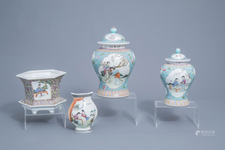 Two Chinese famille rose turquoise ground vases and covers, a wall vase and a jardinière on stand, 20th C.