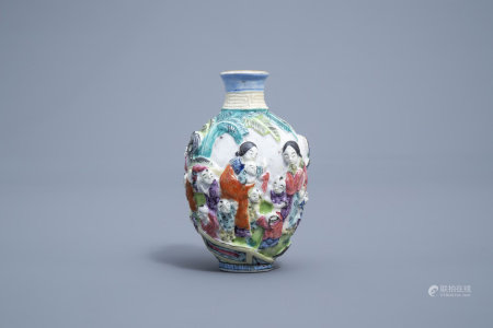 A Chinese famille rose relief molded snuff bottle with ladies and boys, Qianlong mark, 19th C.