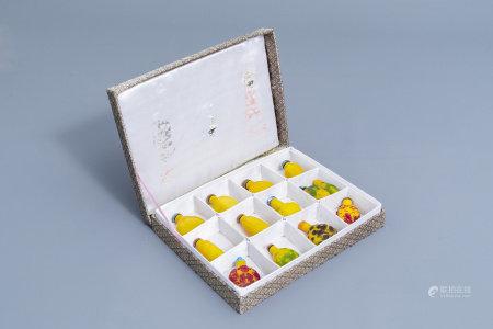Thirteen Chinese yellow monochrome and overlay glass snuff bottles, 20th C.