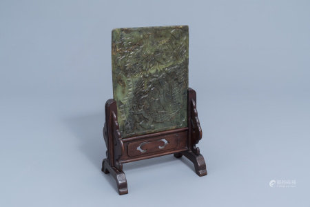 A Chinese jade 'dragons and phoenixes' plaque mounted in a wooden table screen, 20th C.