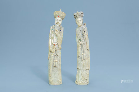 A pair of Chinese inlaid carved ivory figures of the emperor couple, first half of the 20th C.