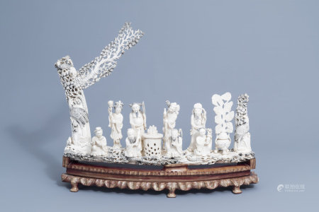 A large Chinese carved ivory 'Eight Immortals' group on a wooden base, first half of the 20th C.