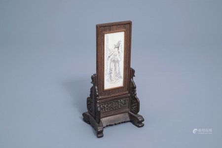 A Chinese wooden table screen with an ivory plaque depicting a lady and a butterfy, ca. 1920