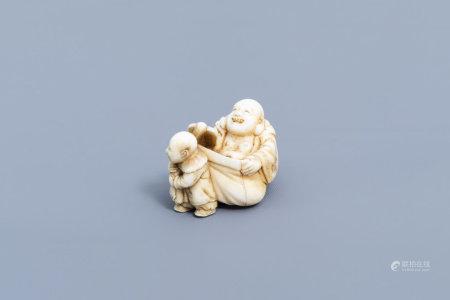 A Japanese ivory netsuke of a laughing Buddha with his servant, signed Shinsai, Edo