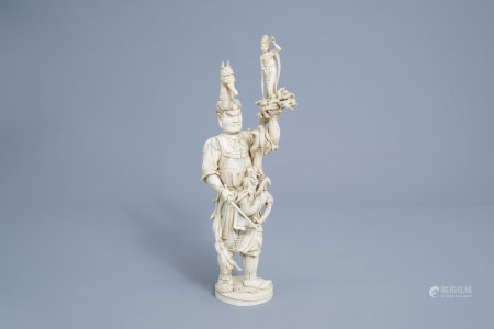 An exceptionally large Japanese ivory okimono of a warlord protecting a lady from the attack of a dragon, Meiji, 19th C.