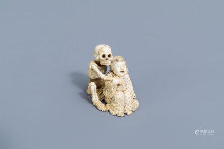 A Japanese ivory okimono with a skeleton and a lady, signed Tomonobu, Meiji, 19th C.