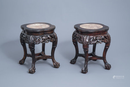 A pair of Chinese carved wooden stands with marble top, 19th/20th C.