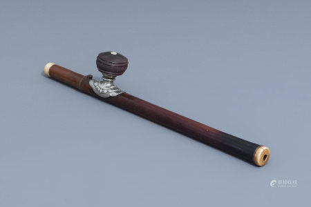 A Chinese bamboo opium pipe finished with a paktong saddle, an ivory mouth- and endpiece and a stoneware damper, 19th C.