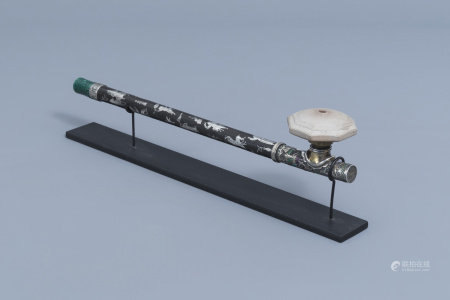 A Chinese silver inlaid opium pipe finished with a enamelled silver saddle, a stained ivory mouthpiece and a stoneware damper, 19th C.