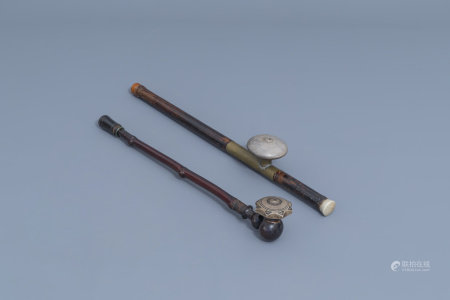 Two Chinese bamboo opium pipes finished with brass, jade, ivory and stoneware, ca. 1900