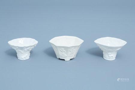 Three Chinese Dehua blanc de Chine cups with molded design, Kangxi