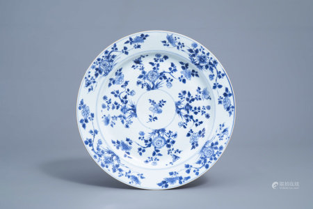 A Chinese blue and white charger with floral design, Kangxi