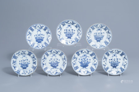 Seven Chinese blue and white plates with in the center a flower basket and on the edges a floral design, Qianlong